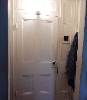 In Simon Truby's former front door, glass sidelights have been replaced by white-painted wood.