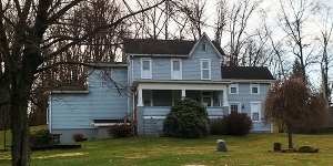 The Hines Sanders house on Hickory Nut Road in North Apollo PA, built circa 1880-1899, is a vernacular 4-Over-4 style structure with an expanded form due to the addition of 4 wings, resulting in an irregular shaped plan.