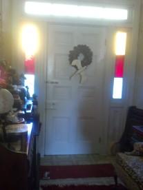 Original color-glass sidelights in Capt Henry's front door.